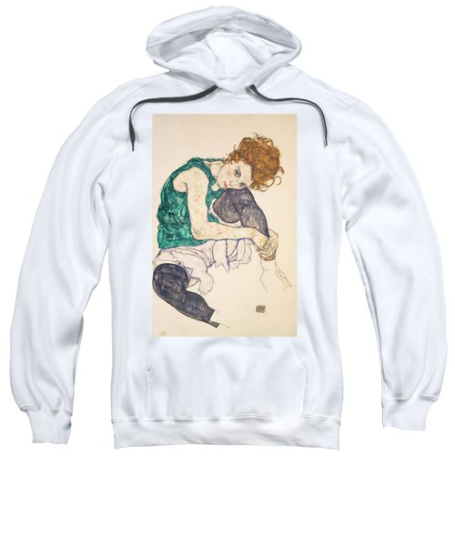 Seated Woman With Legs Drawn Up Sweatshirt