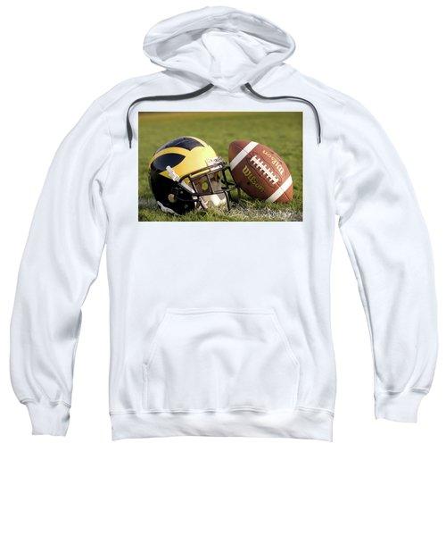 Wolverine Helmet With Football On The Field Sweatshirt