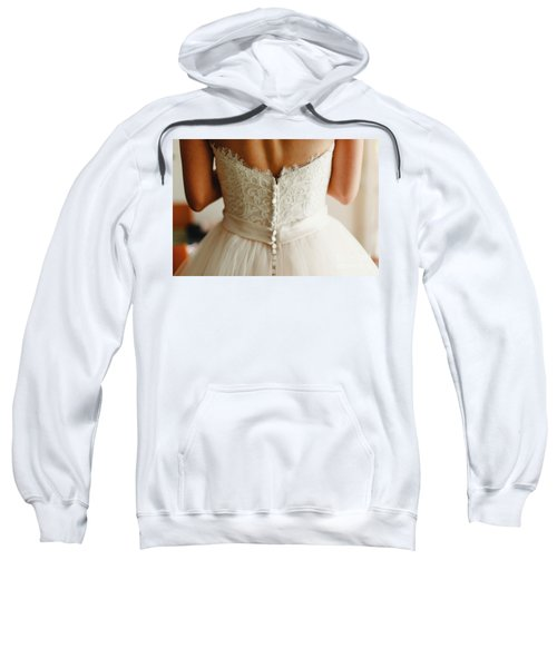 Bride Getting Ready, They Help Her By Buttoning The Buttons On The Back Of Her Dress. Sweatshirt