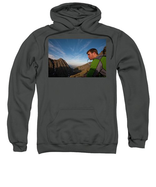 A Man Taking A Water Break On A Ridge Sweatshirt