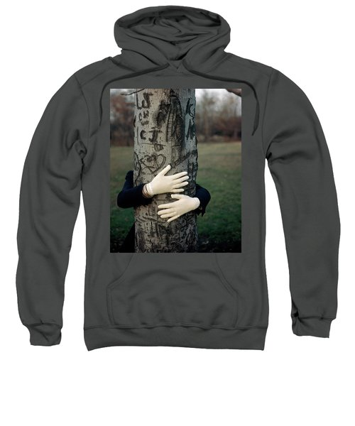 A Model Hugging A Tree Sweatshirt