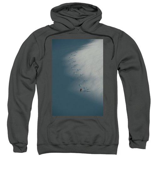 A Ski Guide Dances With A Mountain Sweatshirt