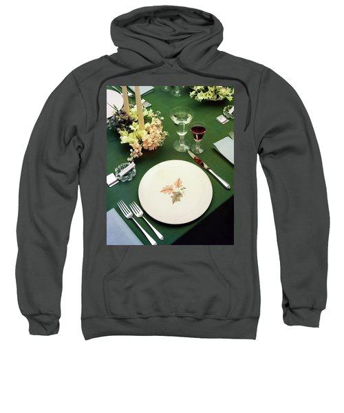 A Table Setting On A Green Tablecloth Sweatshirt