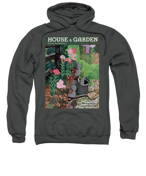 A Watering Can And A Shovel By A Flower Bed Sweatshirt