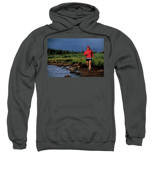 A Woman Trail Runs At Brainard Lake Sweatshirt