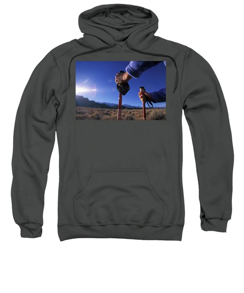 A Womans Forearms And Her Treking Poles Sweatshirt