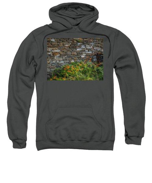 Orange Wildflowers Against Stone Wall Sweatshirt