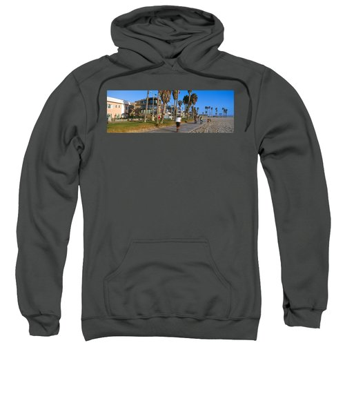 People Riding Bicycles Near A Beach Sweatshirt