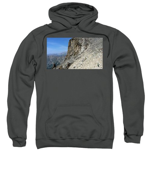 Person Walking Up Steep Stony Sweatshirt