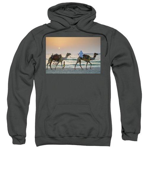 A Little Boy Stares In Amazement At A Camel Riding On Marina Beach In Dubai, United Arab Emirates Sweatshirt