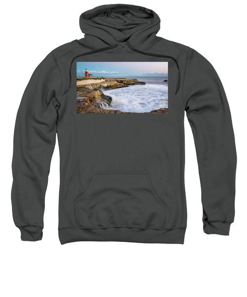 Long Exposure Of Waves Against The Cliff With Lighthouse In Shot Sweatshirt