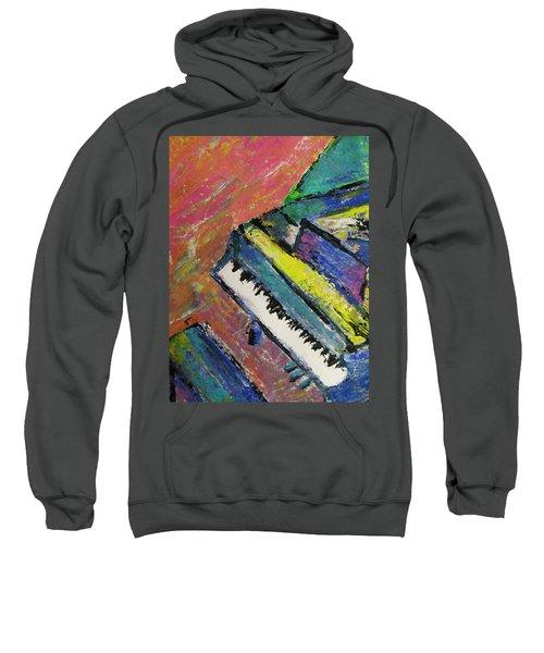Piano With Yellow Sweatshirt