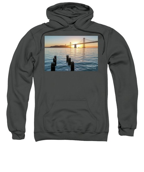 Six Pillars Sticking Out The Water With Bay Bridge In The Backgr Sweatshirt
