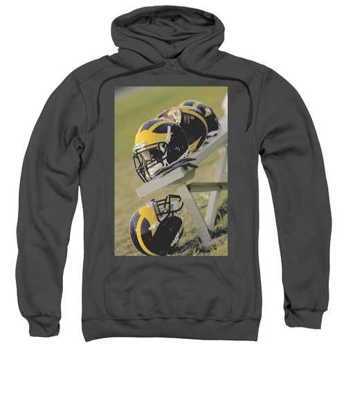 Wolverine Helmets On A Football Bench Sweatshirt