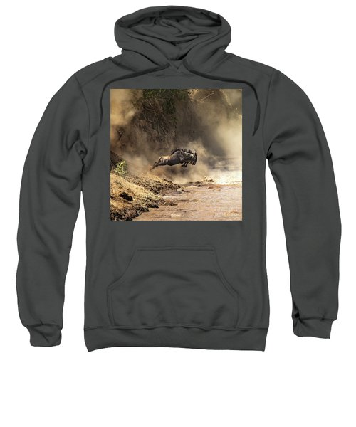 Wildebeest Leaps From The Bank Of The Mara River Sweatshirt