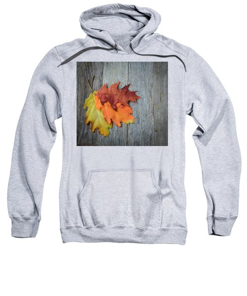 Autumn Leaves On Rustic Wooden Background Sweatshirt