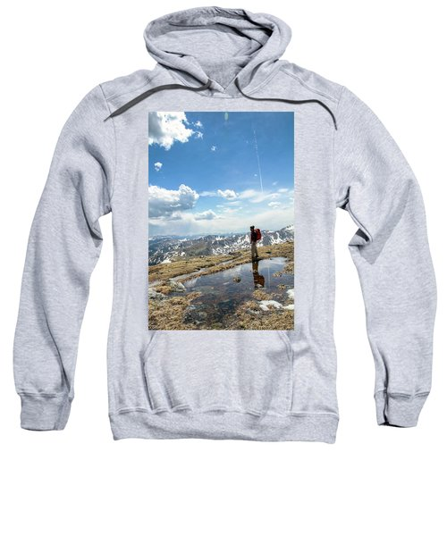 A Backpacker Stands Atop A Mountain Sweatshirt