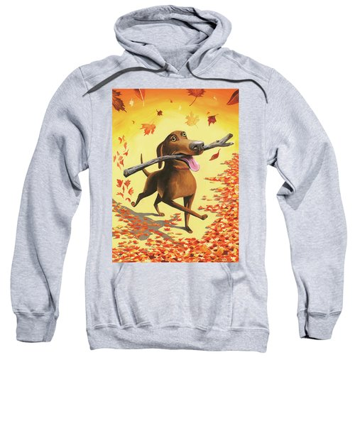 A Dog Carries A Stick Through Fall Leaves Sweatshirt