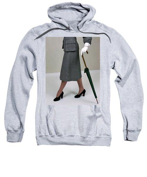 A Model Holding An Umbrella Sweatshirt