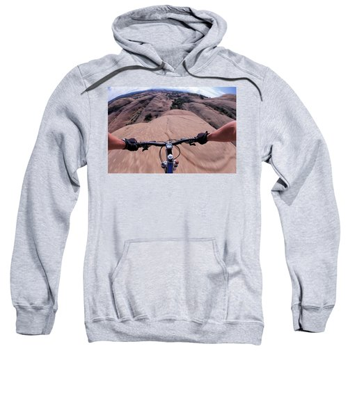A View Of A Female Mountain Bikers Sweatshirt