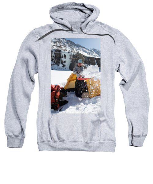 A Woman Shovelling Snow Away Sweatshirt