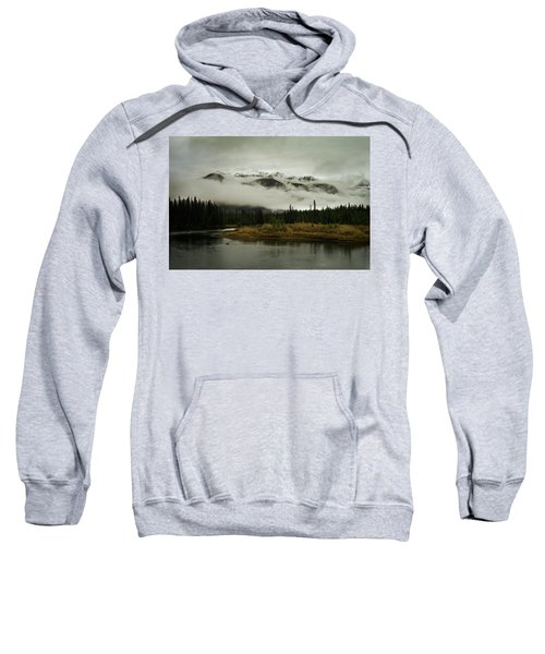 Mountains In Clouds Behind A Lake Sweatshirt