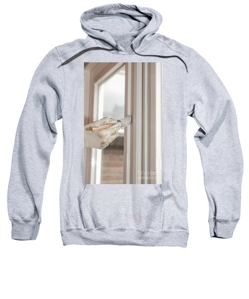 Painting A Window With White Sweatshirt
