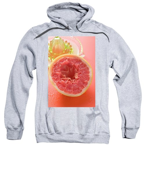 Squeezed Pink Grapefruit In Front Of Citrus Squeezer Sweatshirt