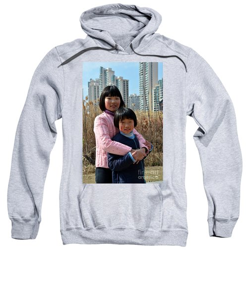 Two Chinese Teen Sisters Hug  And Embrace Shanghai China Sweatshirt