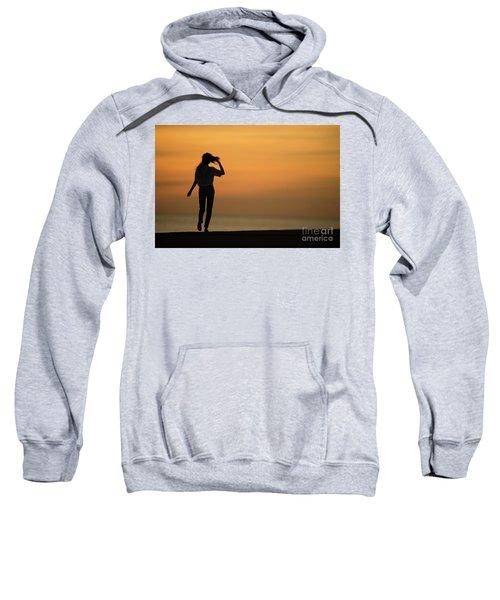 A Slim Woman Walking At Sunset Sweatshirt