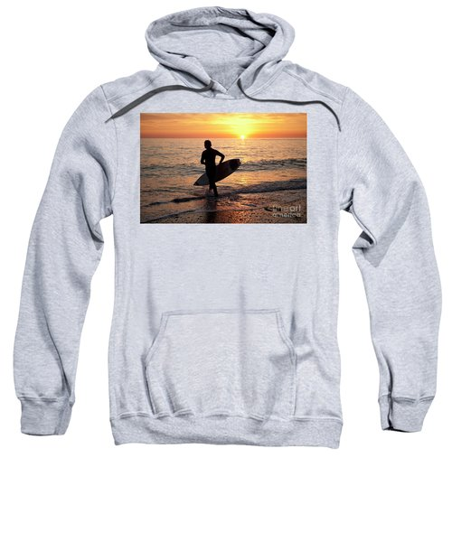 A Young Man Surfing At Sunset Off Aberystwyth Beach, Wales Uk Sweatshirt