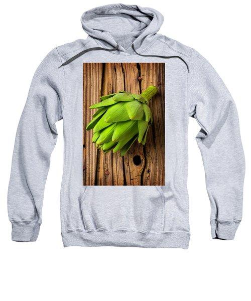 Artichoke On Old Wooden Board Sweatshirt by Garry Gay