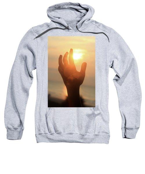 Hand Reaching Fore The Sun Sweatshirt