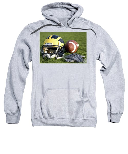 Helmet On The Field With Football And Gloves Sweatshirt