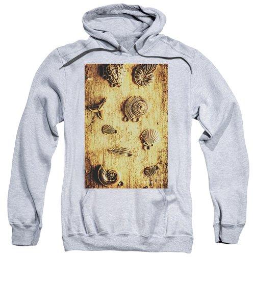 Seashell Shaped Pendants On Wooden Background Sweatshirt