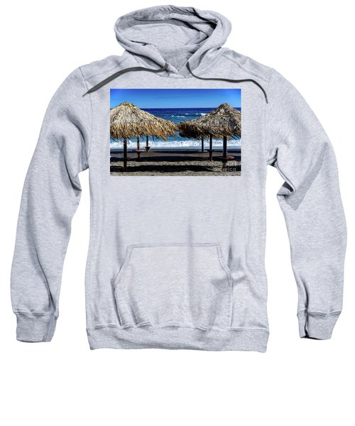 Wood Thatch Umbrellas On Black Sand Beach, Perissa Beach, In Santorini, Greece Sweatshirt
