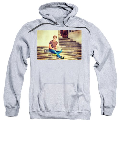 Young Man Working Outside In New York Sweatshirt