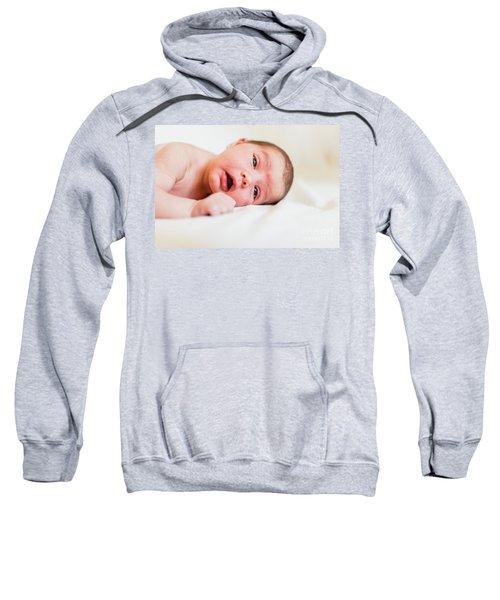 Portrait Of Newborn Baby Girl Feels Safe And Awake To A New Life. Sweatshirt