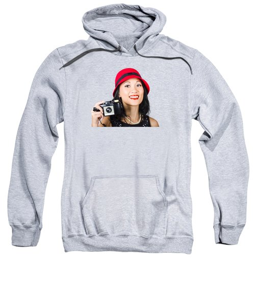 Smiling Woman Holding Retro Camera In Hand Sweatshirt