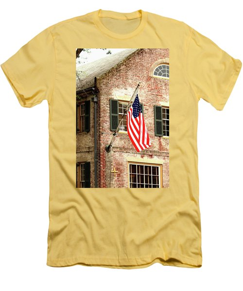 Men's T-Shirt (Slim Fit) featuring the photograph American Flag In Colonial Williamsburg by Emanuel Tanjala