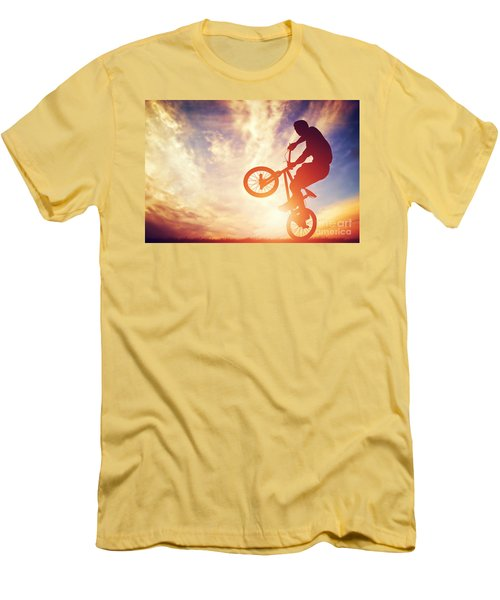 Man Riding A Bmx Bike Performing A Trick Against Sunset Sky Men's T-Shirt (Athletic Fit)
