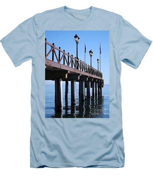 Marbella Pier Spain Men's T-Shirt (Slim Fit) by Clare Bevan