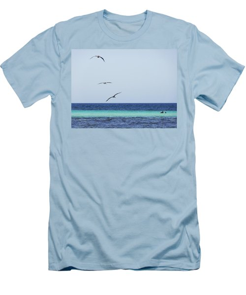 Pelicans In Flight Over Turquoise Blue Water.  Men's T-Shirt (Athletic Fit)