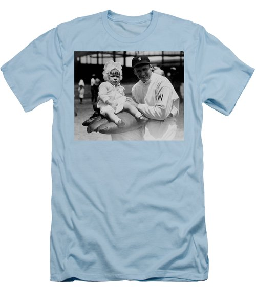 Men's T-Shirt (Slim Fit) featuring the photograph Walter Johnson Holding A Baby - C 1924 by International  Images