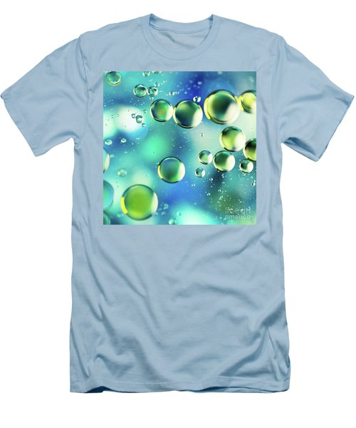 Men's T-Shirt (Slim Fit) featuring the photograph Macro Water Droplets Aquamarine Soft Green Citron And Blue by Sharon Mau