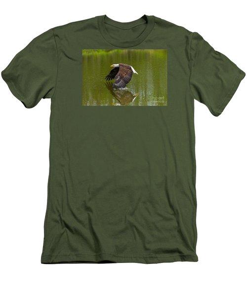 Bald Eagle In Low Flight Over A Lake Men's T-Shirt (Slim Fit) by Les Palenik