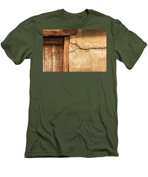 Men's T-Shirt (Slim Fit) featuring the photograph Cracked Lime Stone Wall And Detail Of An Old Wooden Door by Semmick Photo