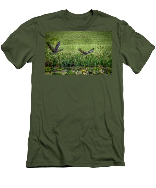 Geese In Flight Men's T-Shirt (Slim Fit) by Ray Congrove