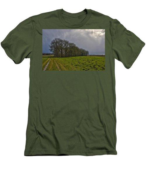 Group Of Trees Against A Dark Sky Men's T-Shirt (Slim Fit) by Frans Blok