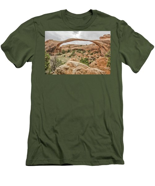 Men's T-Shirt (Athletic Fit) featuring the photograph Landscape Arch Against A Cloudy Sky by Sue Smith